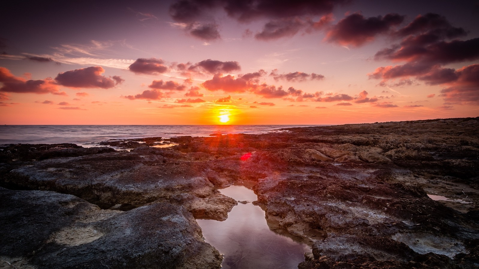 A beautiful October sunset in Paphos, photography by Anup Shah